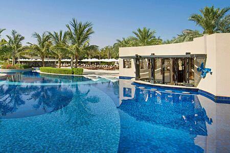 pool and pool bar at Waldorf Astoria UAE