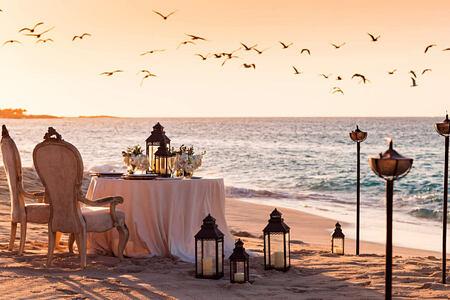 Dining on the beach at Four Seasons Ocean Club Bahamas
