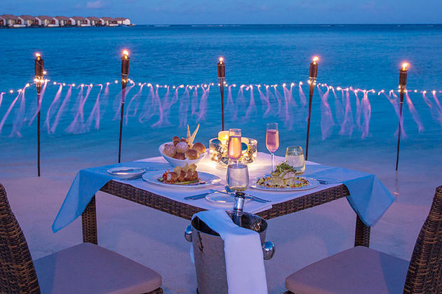 Dinner by the beach at The Residence Maldives