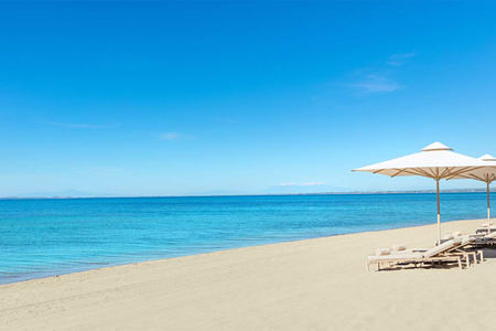 Empty beach at Ikos Oceania Greece