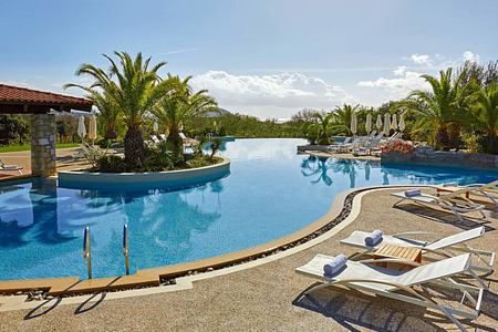 Lagoon pool and chairs at Westin Resort Costa Navarino Greece