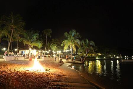 Nightime beach activities at St James Club and Villas Antigua