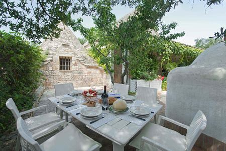 Outdoor dining at Trulli Volpe Italy