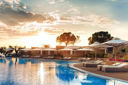 Sunset at Pool area at Ikos Olivia Greece