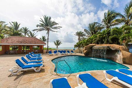 Royal suites waterfall pool at St James Club and Villas Antigua