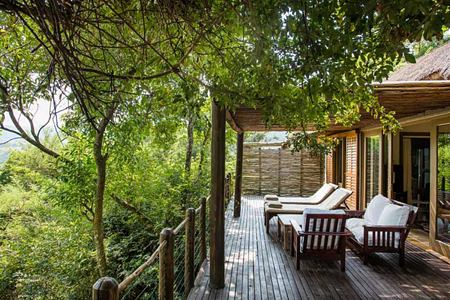 Villa deck with view across veld at Karkloof Safari Spa KZN South Africa