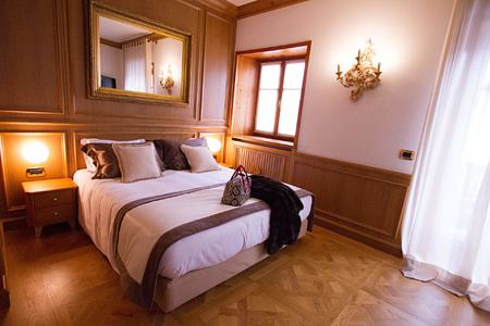 White and brown bed scarf Bedroom at Hotel Ambra Italy