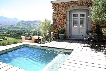 Hillside Cottage pool and view across mountains