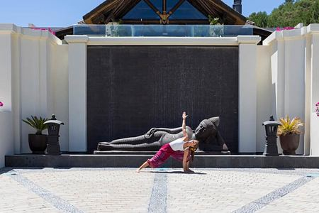 Woman enjoying yoga outside Shanti Som in Spain