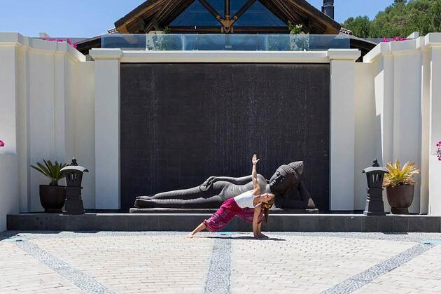 Woman enjoying yoga outside Shanti Som in Spain