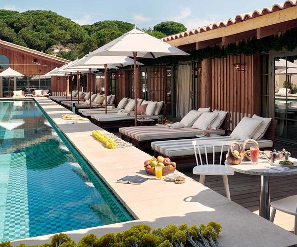 Swimming pool with beds and chairs at Lily of the Valley France