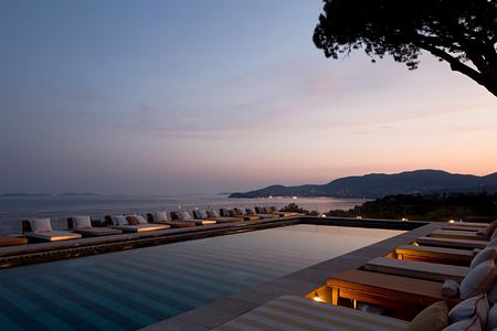 Sunset view across the pool and sea at Lily of the Valley France
