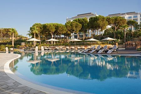 exterior view of the conrad algarve featuring pool and sun loungers