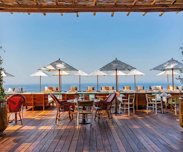 Outdoor dining area with sea view at lily of the valley cote dazur