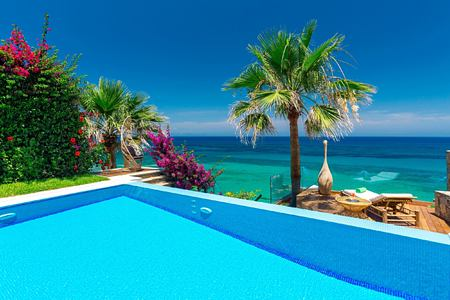 View across swimming pool and out to ocean from presidential villa