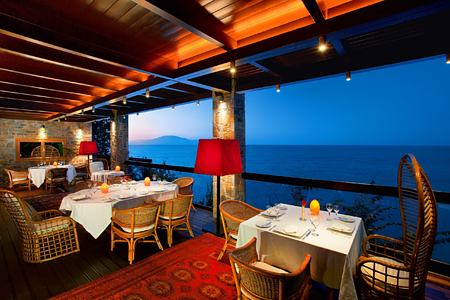Club house restaurant outdoor terrace facing out to the sea