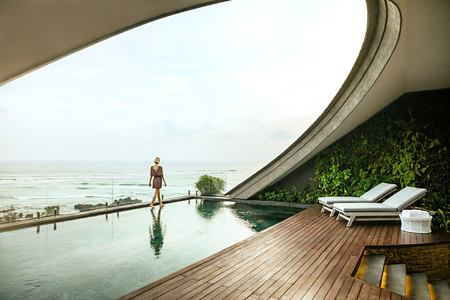 Women walking at the edge of pool with views out to the ocean at COMO Canggu