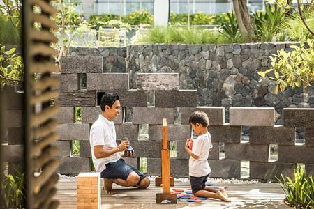 Child playing with kids club staff at Como Canggu Bali