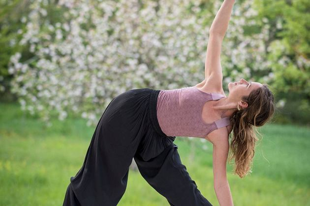 yoga instructor demonstrating triangle pose