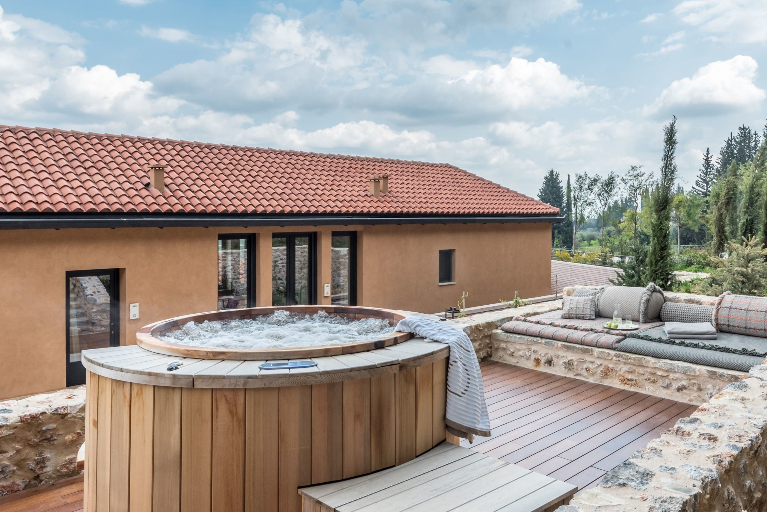 Outdoor hot tub and decked area of a byzantium suite at Euphoria Greece