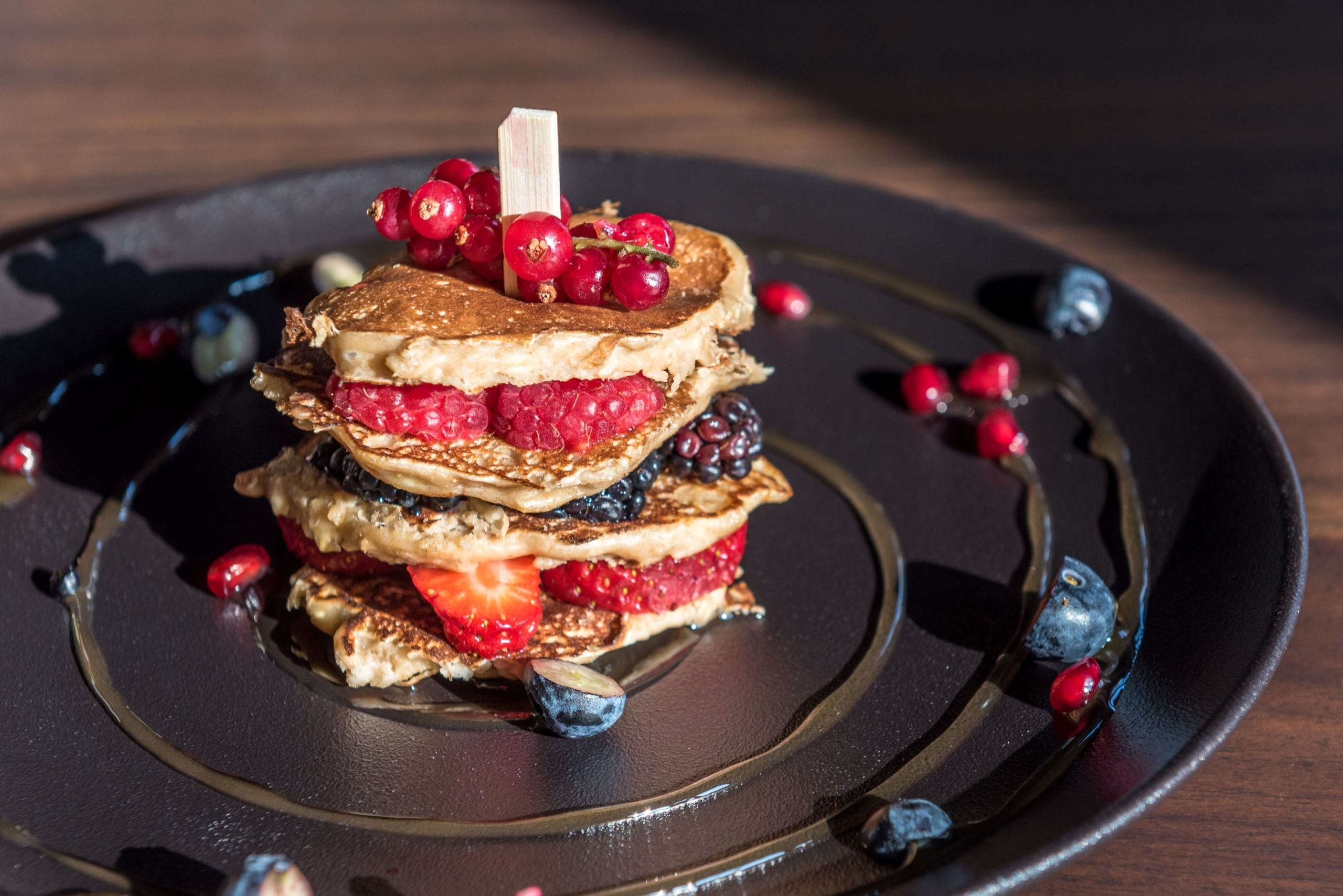 Stack of pancakes with fresh berries and compote at Gaia restaurant