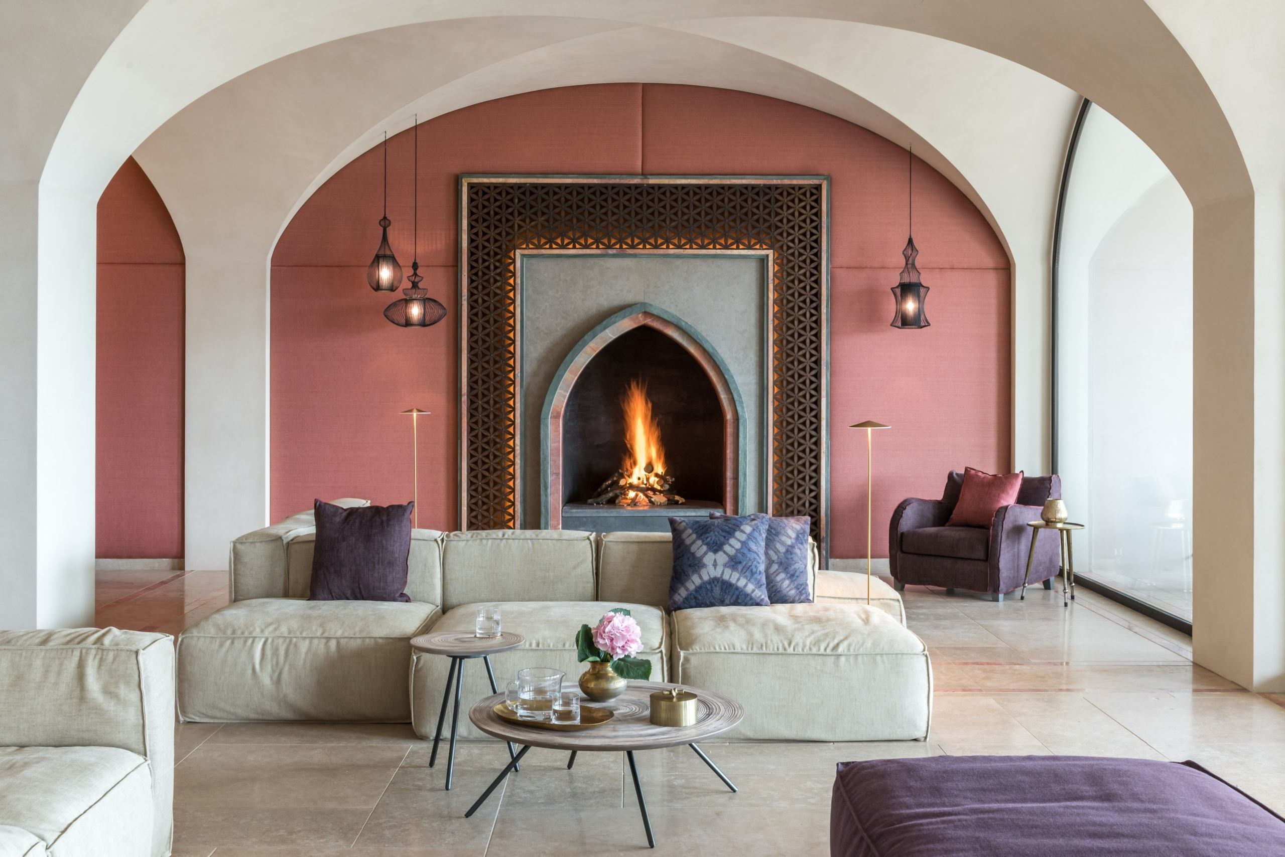Lobby with open fire and comfy sofas at Euphoria Greece