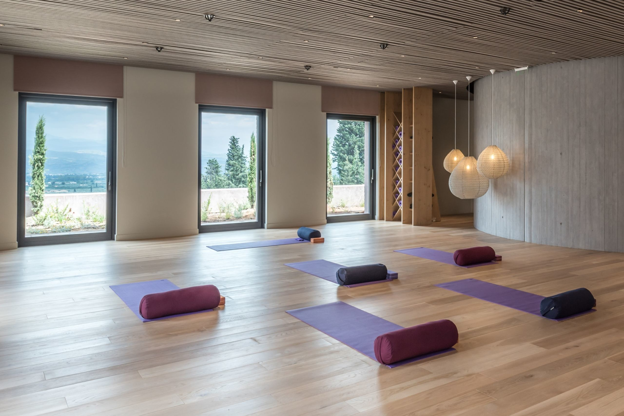 Yoga area with big windows and views across the countryside