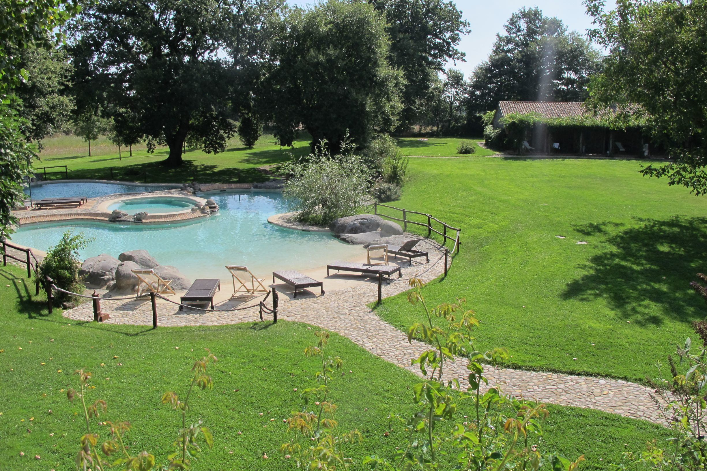 External pool and gardens at La Locanda