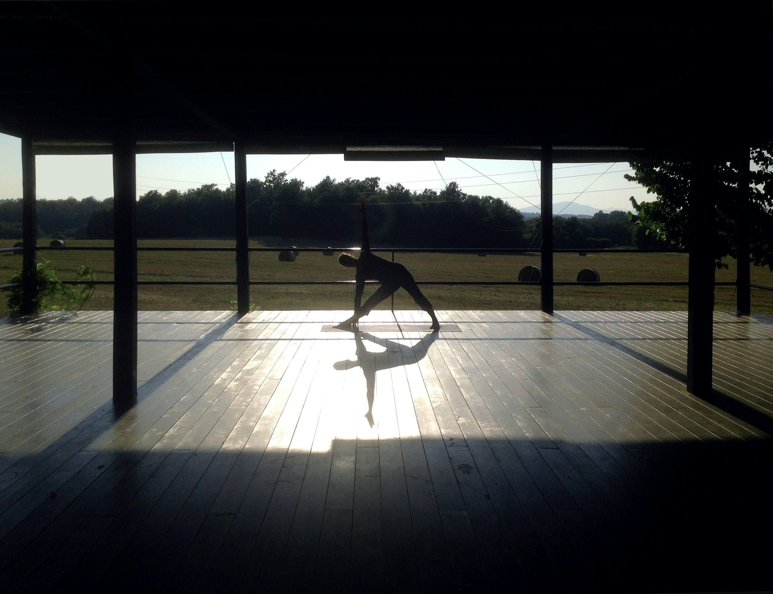 Woman doing yoga in the outdoor yoga area