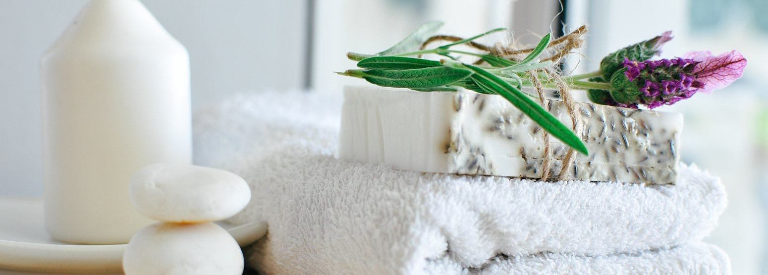 White towel soap stones and candle spa area