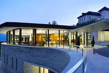 Clinique La Prairie Switzerland at dusk-header-image