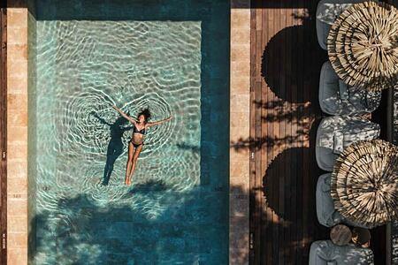 Oku Hotel Ibiza aerial view of the pool-header